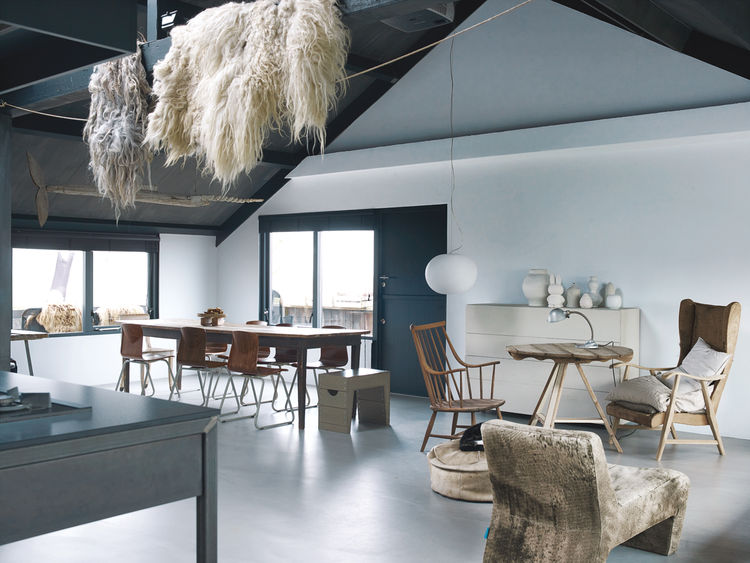 Modern living space with sheep's wool hanging and antique furniture