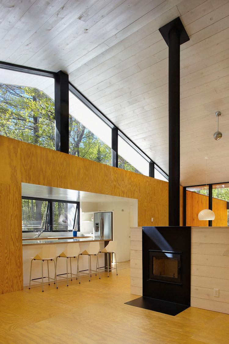 Kitchen central space with Rais wood-burning fireplace