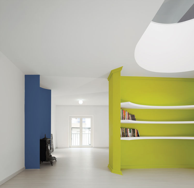 Carved green wall bookshelf designed by Pedro Gadanho