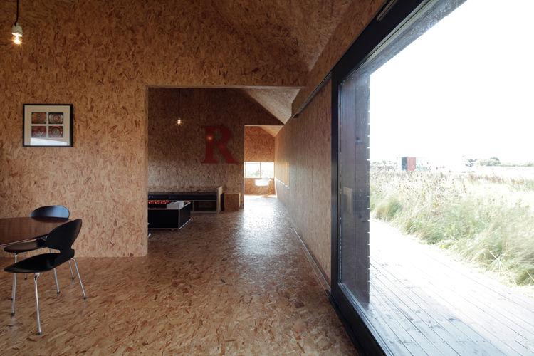Modern farmhouse renovation interior with OSB walls