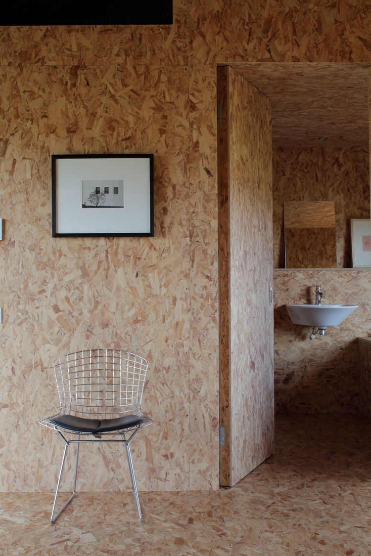 Modern bathroom hallway covered in OSB