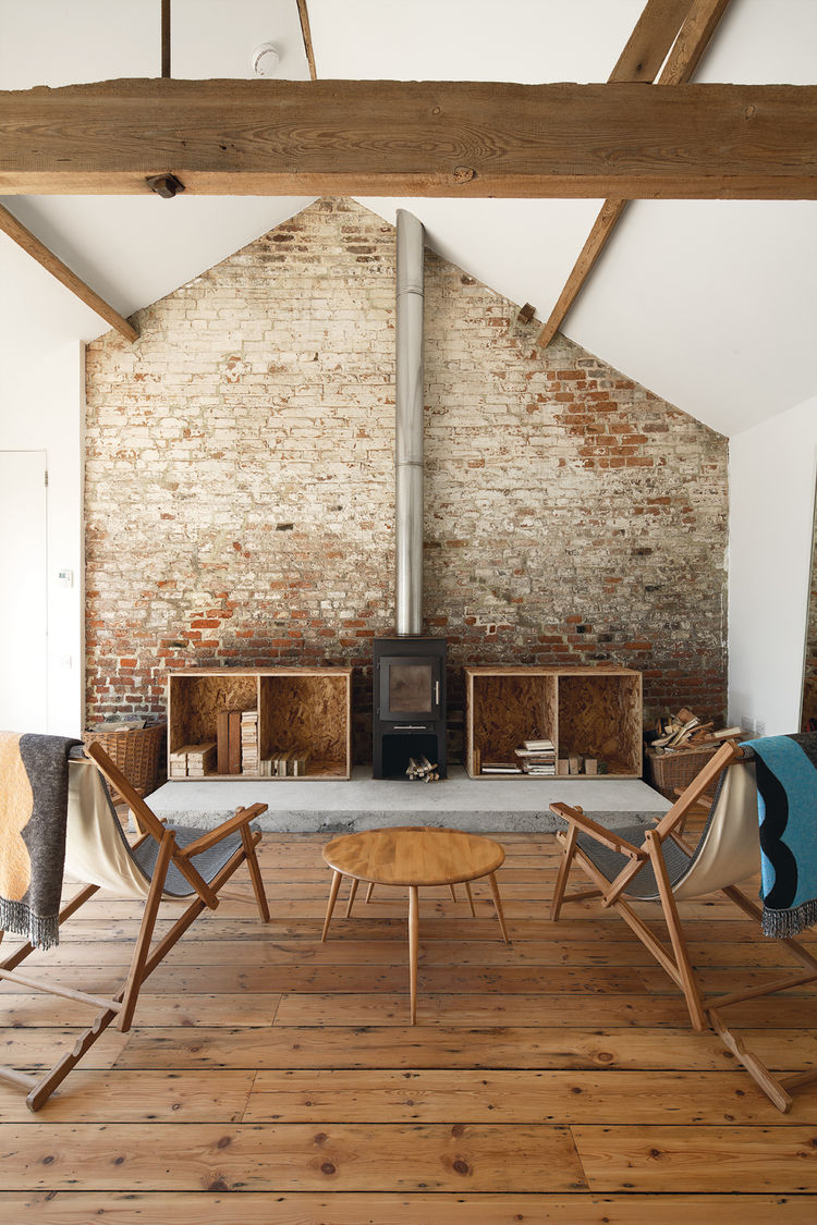 Living room with fireplace and reclaimed timber floors