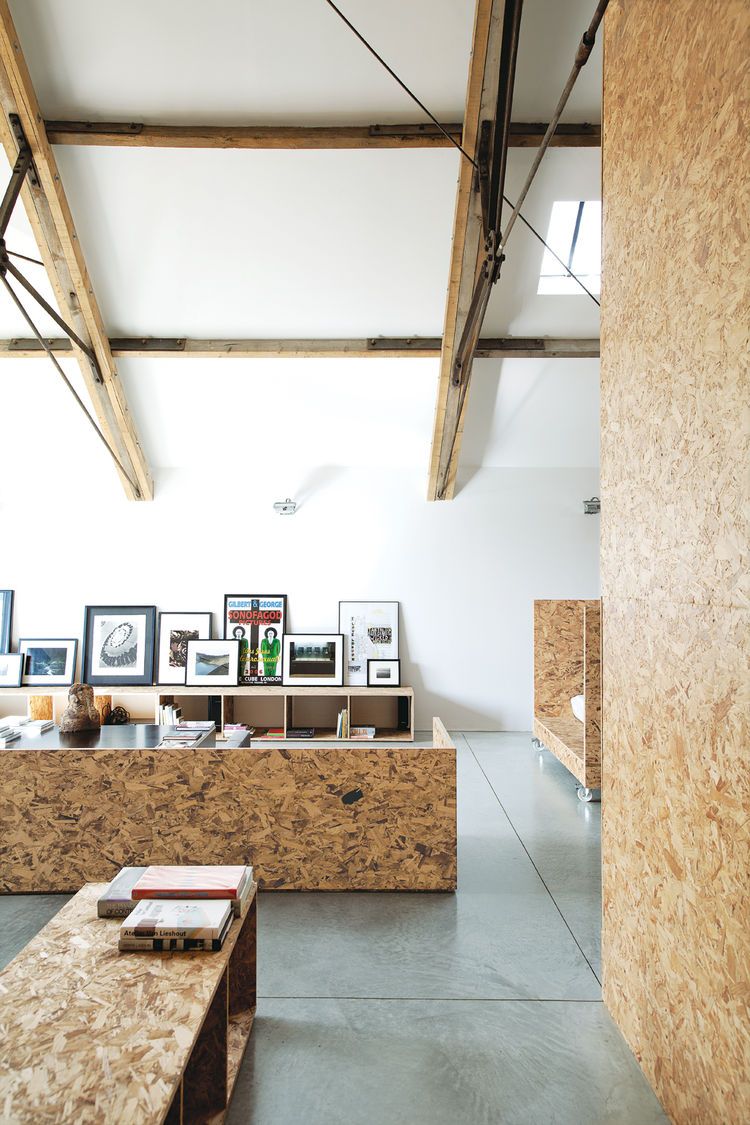 Modern living room area covered in OSB walls
