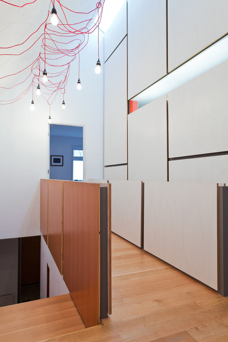Modern hallway with floor-to-ceiling shelving units