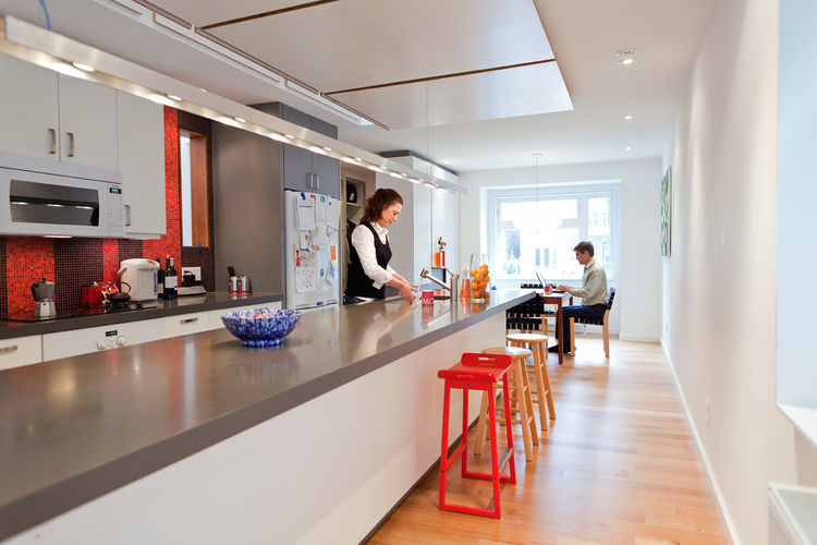 Modern kitchen with long countertop and overhead lighting