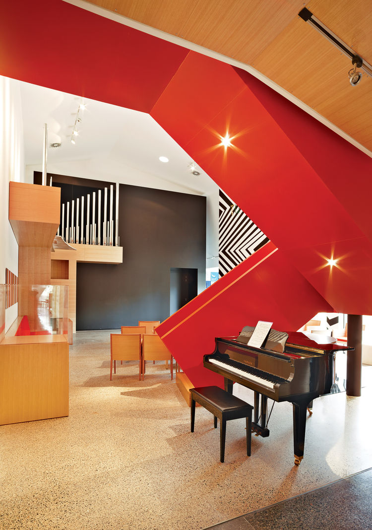 Modern music room with a red staircase
