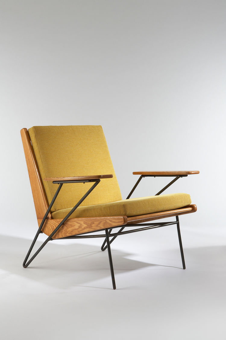 VIntage upholstered armchair with metal legs by Pierre Guariche