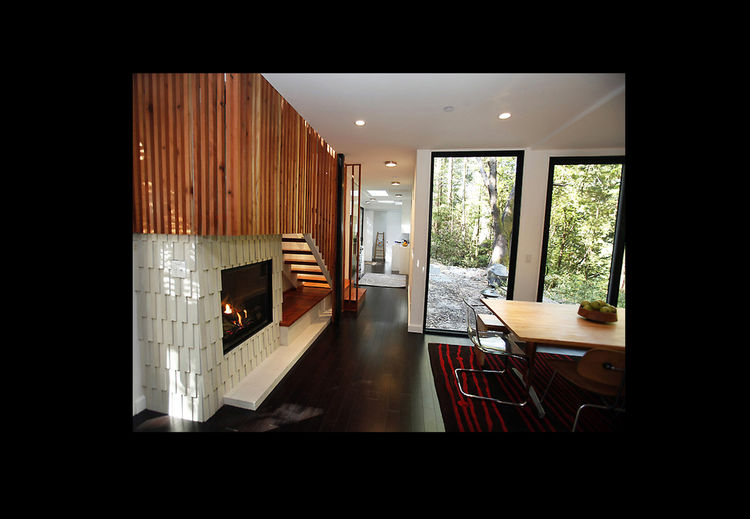 Redwood stairs and gas heat fireplace.