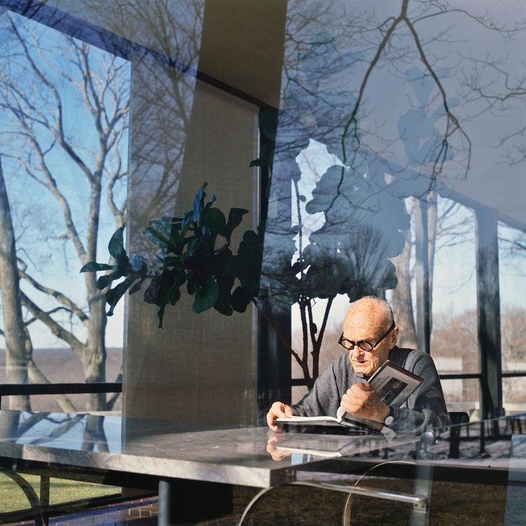 Architect Philip Johnson reading a book