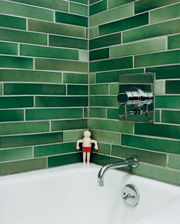 Modern bathroom with green Heath tile wall