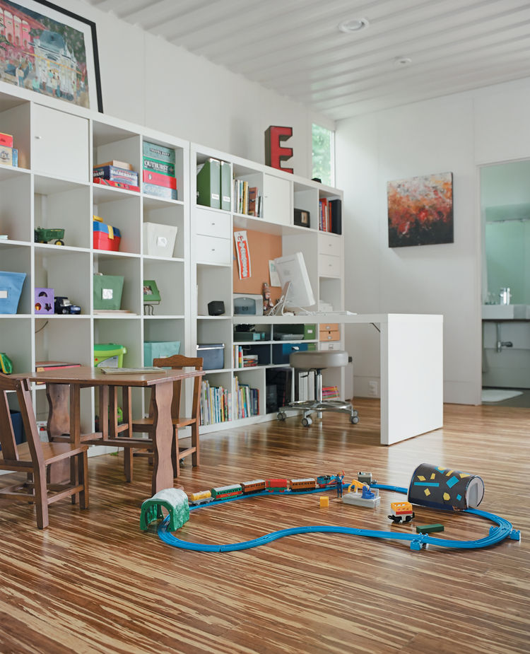 "In the cutout of the 40-foot-long container along the northern side of the house is the office and play area. It's a mix of new and old: The bookcase and desk are from <a href=""http://www.ikea.com/us/en/catalog/categories/series/09064"">Ikea's Expedit livi"
