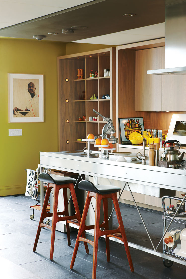 Modern kitchen with bar stools and wooden cabinets