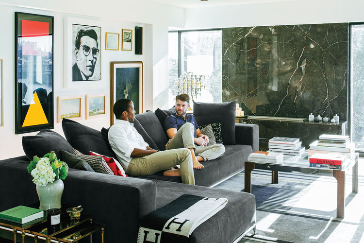 Modern living room with George sectional sofa and Gunta Stölzl rug