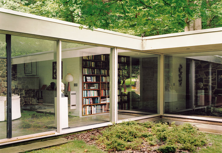 Renovated Breuer house in Baltimore exterior with large glass windows