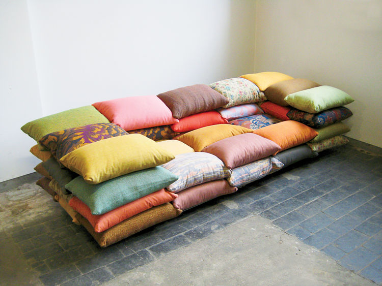 Stacked colorful pillows sofa