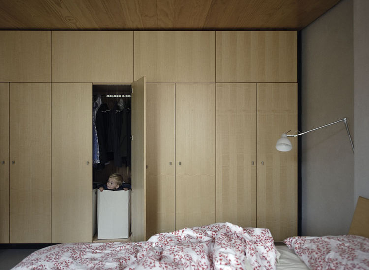 Built-in wood closet in bedroom