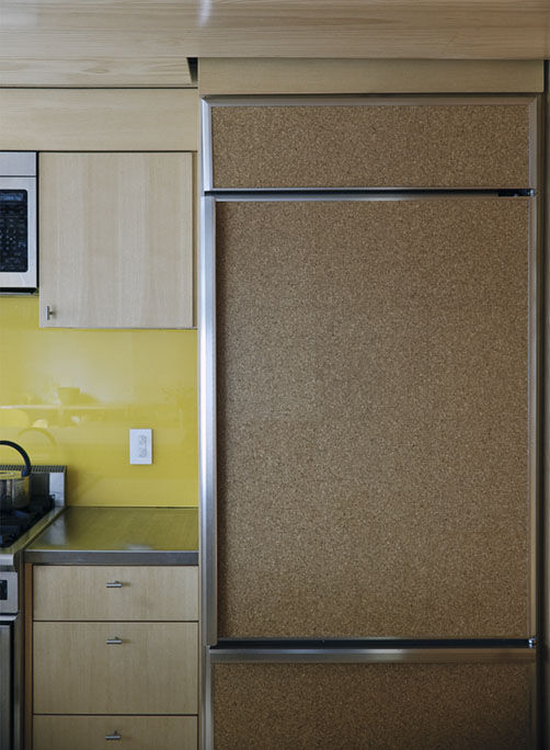 Cork-clad refrigerator in kitchen