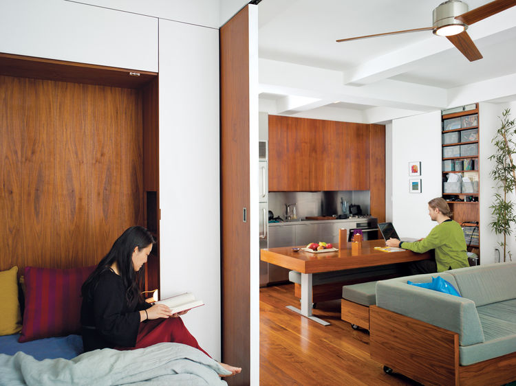 Sliding door divider between bedroom and kitchen