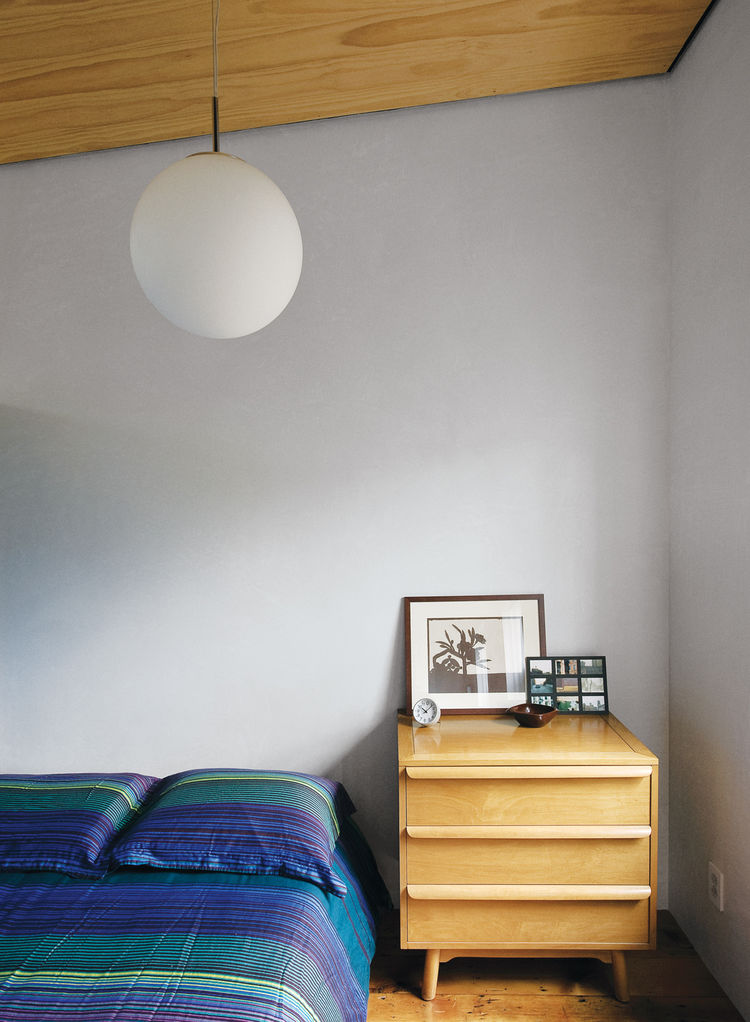 Guest room with mid-century Heywood Wakefield-esque dresser and pendant lamp