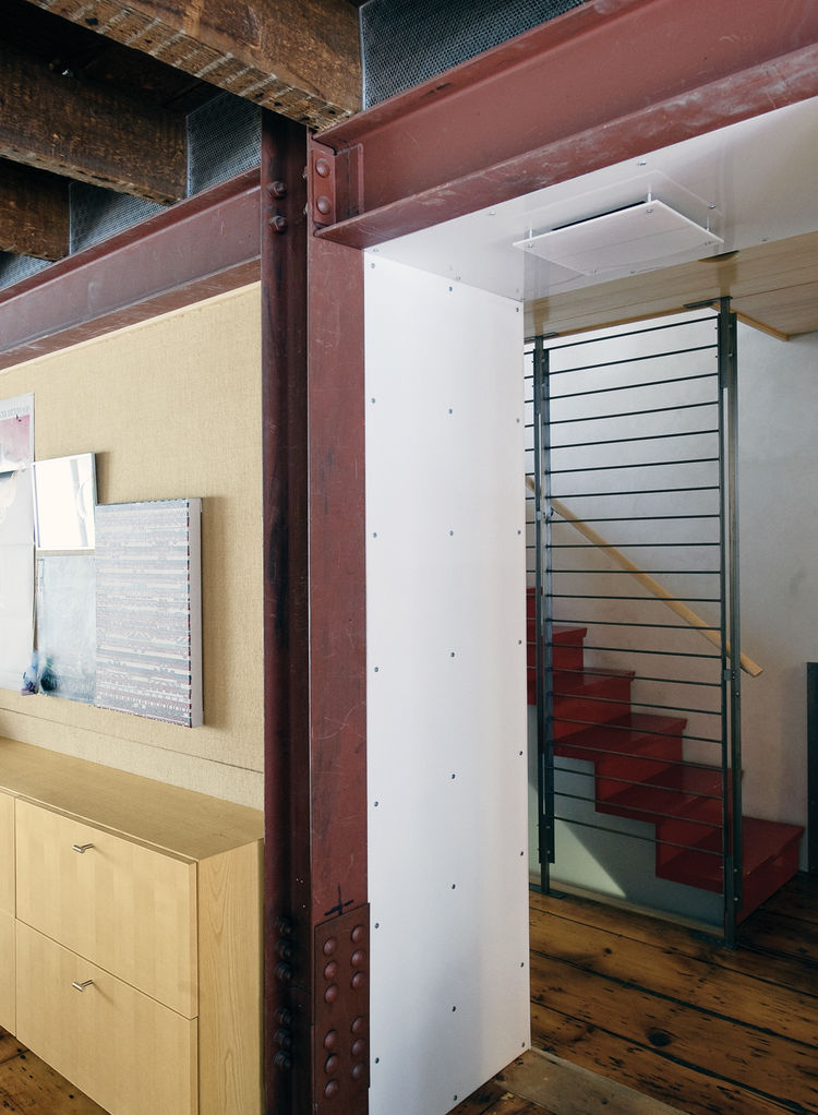 Exposed steel beams and staircase by Wesley Martel