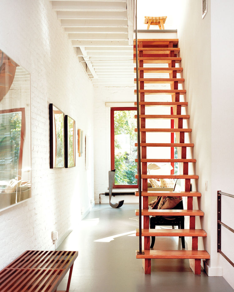 Orange red staircase and exposed ceiling beams