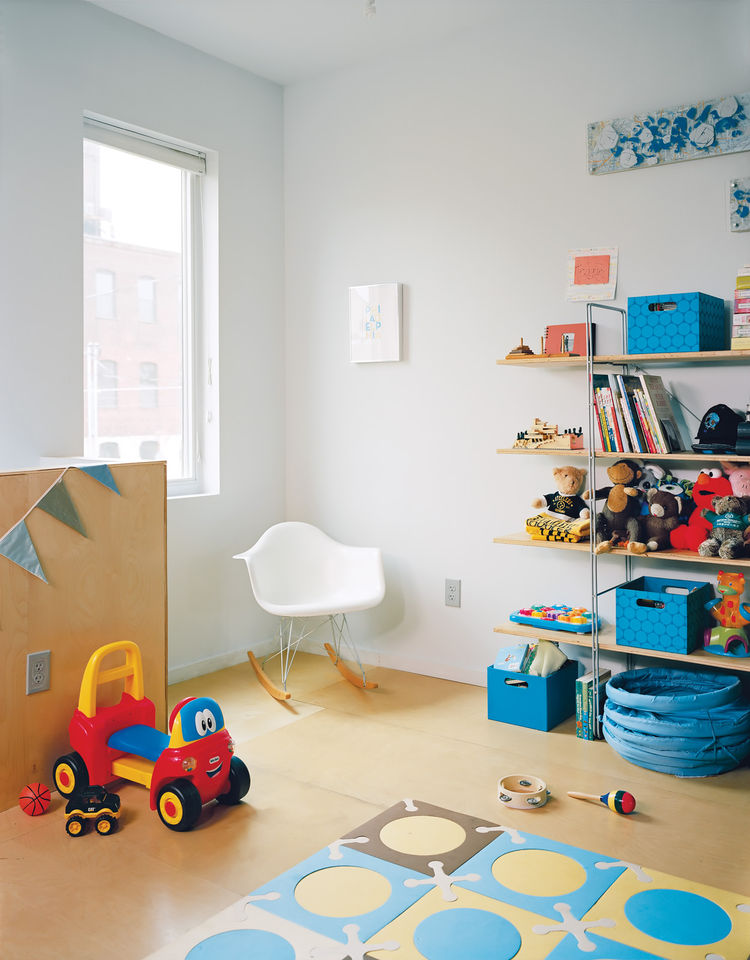Children's room with white Eames chair and patterned floor playmat