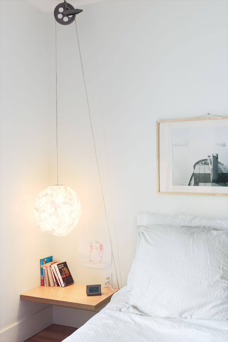 Adjustable bedside reading light in bedroom