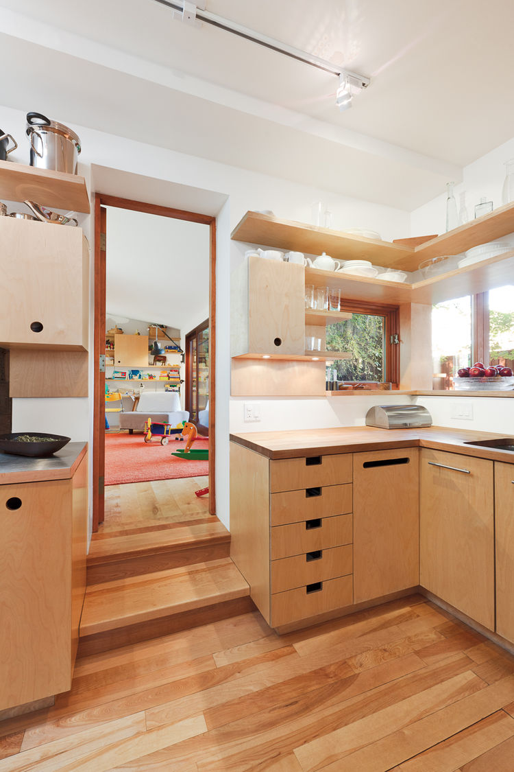 Modern wood kitchen with stainless-steel pull bars by Richelieu