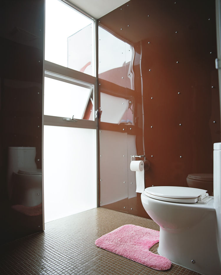 Guesthouse bathroom with flooded natural day light
