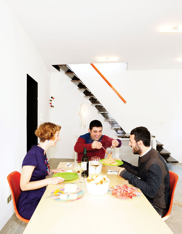 Dining table with Eames Hang-It-All family portrait