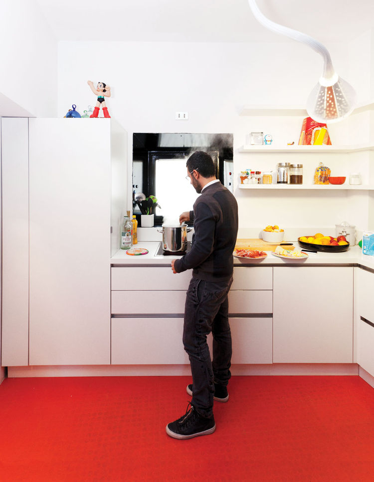 Modern kitchen with orange rubber floor