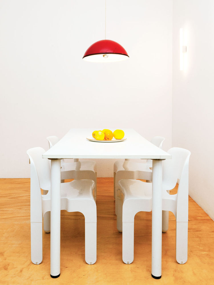 Four Universale stacking chairs by Joe Colombo for Vitra in dining room