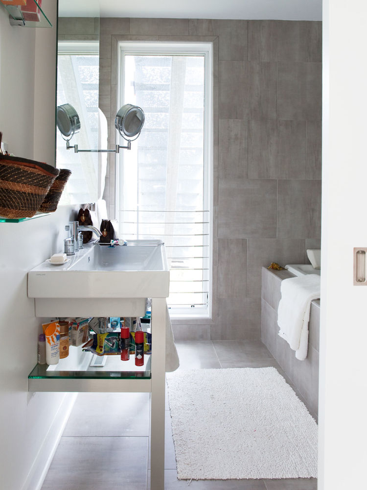 Gray-tiled bathroom with sliding door