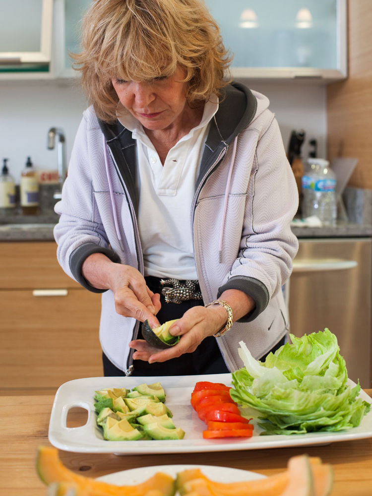 Nancy Church preparing food in her kitchen
