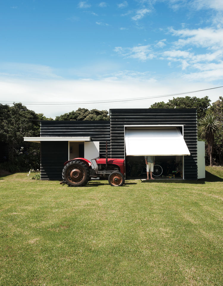 Outdoor boat shed with tractor