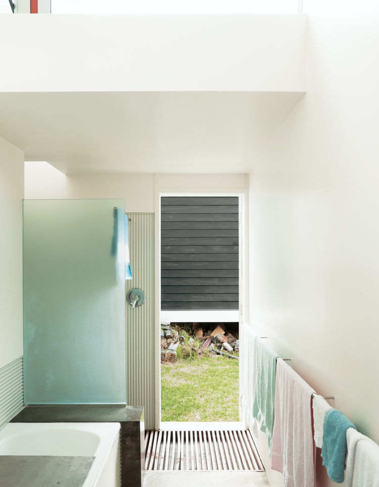 Modern bathroom with corrugated steel walls