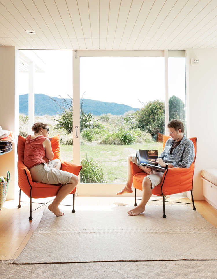 Living room with orange cushion chairs