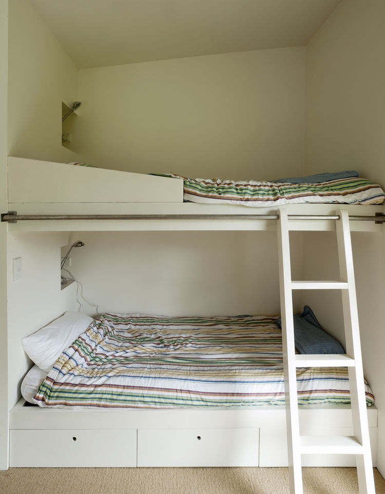 Boys bedroom with bunk bed and rolling ladder