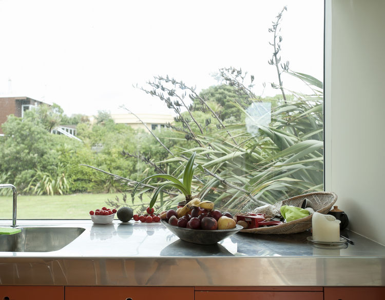 Stainless steel countertops near the window