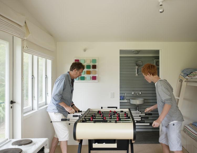 Foosball table in beach house living room
