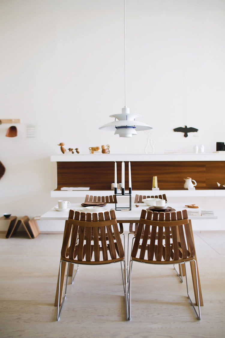 Dining room set up with Louis Poulsen lamp and Scandia chairs