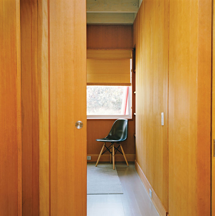 Bedroom with wood walls and sliding pocket door