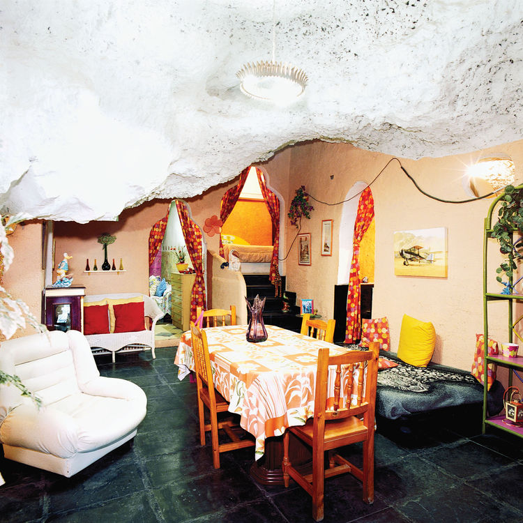 Dining living room with volcano rock ceiling