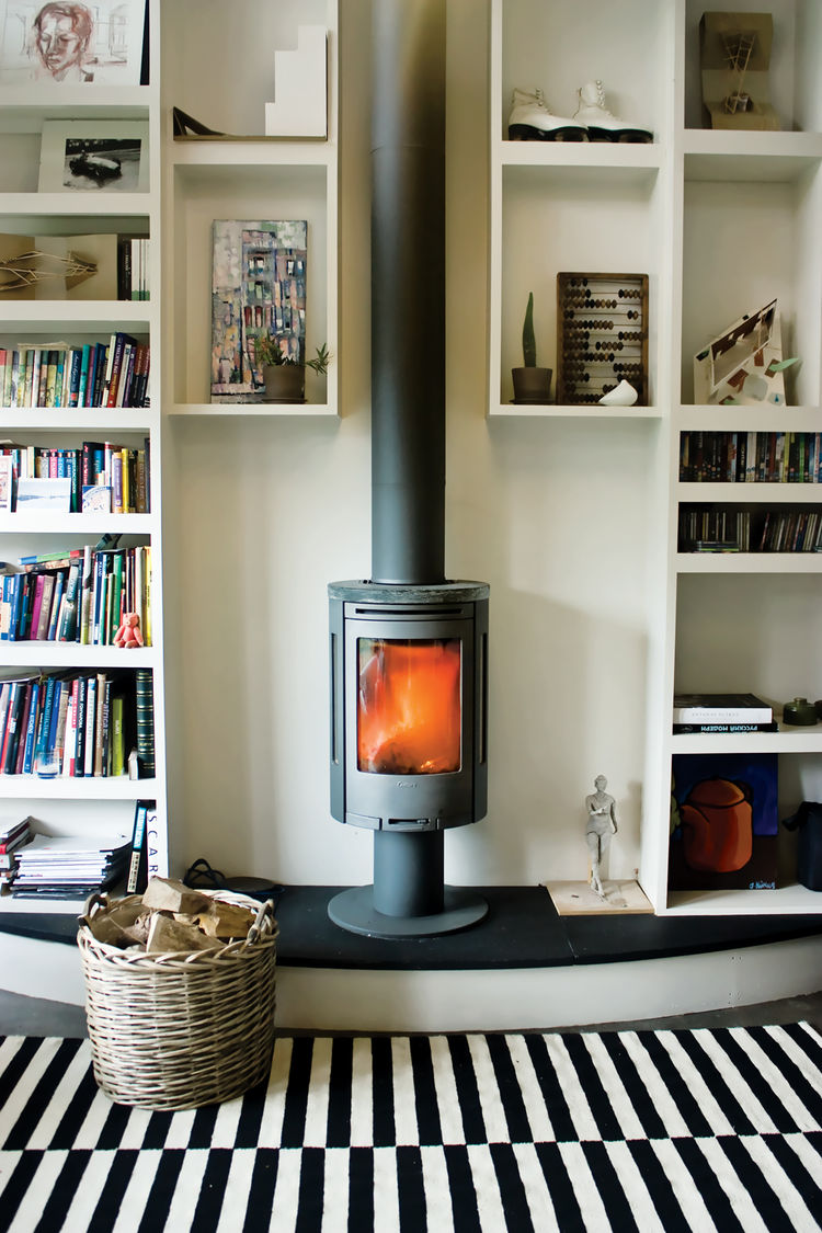compact wood-burning stove in a small studio