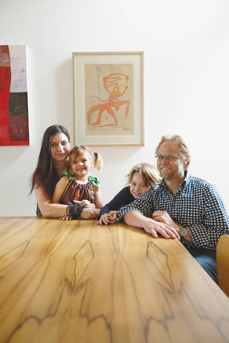 Family portrait at dining table made from black heart sassafras wood