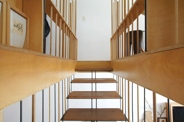 Detail of steel staircase with recycled blackbutt wood treads