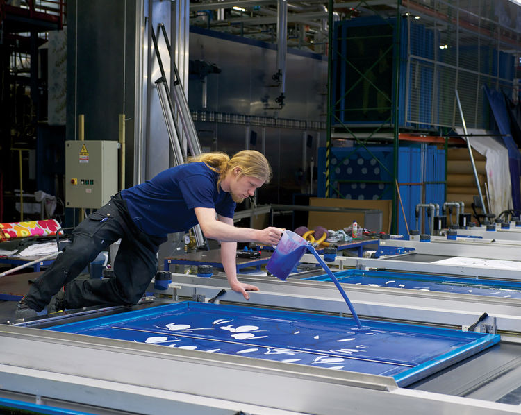Marimekko employee adding ink to a print