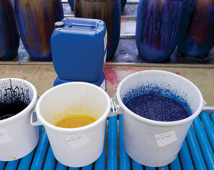 Fabric dye buckets at the Marimekko factory in Helsinki, Finland