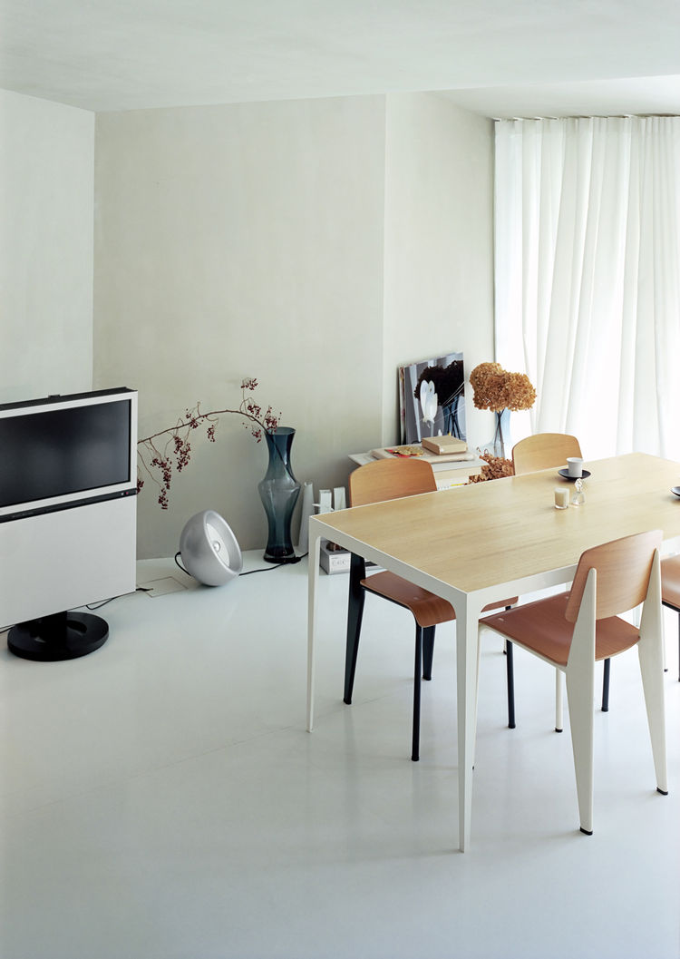 Living room with custom-designed steel-and-paulownia dining table