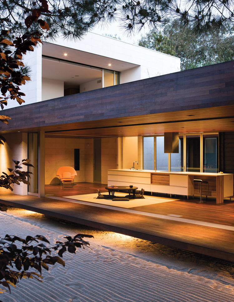 Outdoor view of living room and kitchen clad in ipe wood